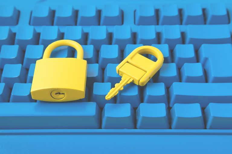 Yellow padlock and key and blue keyboard. How to lock cells in Excel
