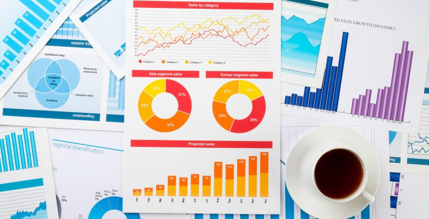 business charts and graph on the table with coffee